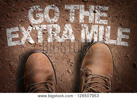 Top View of Boot on the trail with the text: Go The Extra Mile