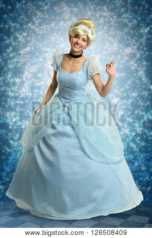 Portrait of beautiful woman dressed in princess costume over magical background
