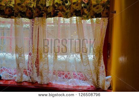 Bright curtains with a light and a window