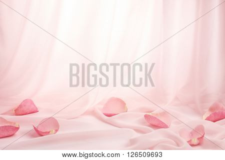 Rose petals on soft silk
