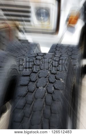 Detail shot of a large tire zoomed with motion