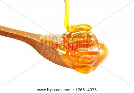 honey dripping in a bowl isolated on white background