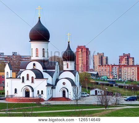 KLAIPEDA, LITHUANIA - 12 APRIL 2016: Pokrov-Nikolskaya orthodox church in Klaipeda, Lithuania. Was built in 2000, in the public park. Has beautiful view in any season, and located next to city lake.