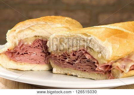 Mortadella traditional Italian sausage sandwich. Wood background.