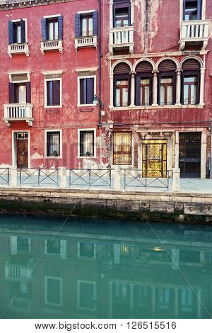 Architecture of Venice - houses reflected in the canal. Venice Veneto Italy