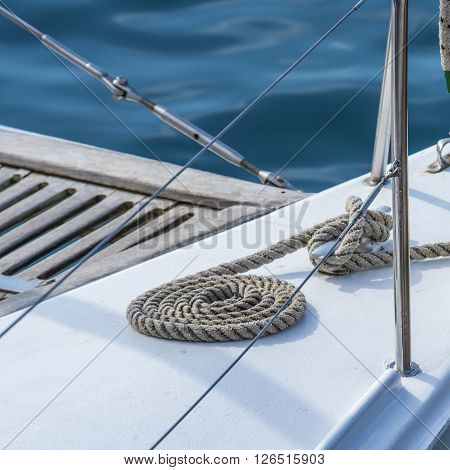 Ship's gear neatly stowed on the deck of the yacht. The yacht is ready to go to sea.