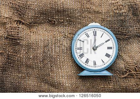 vintage alarm clock on vintage background