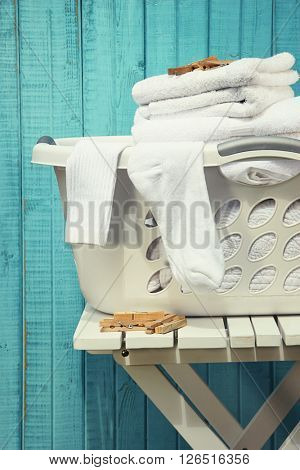 Laundry basket with towels and socks