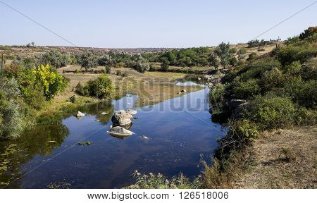 the small still hush river with stones