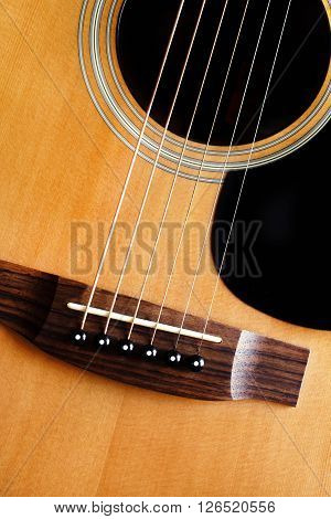 Wooden acoustic guitar isolated with white background closeup, strings