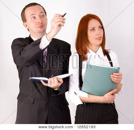 "a male businessman is showing something to his female colleague  - See similar images of this ""Business People"" series in my portfolio"