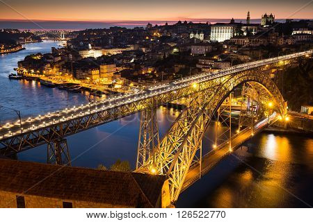 Night view of the historic city of Porto Portugal with the Dom Luiz bridge
