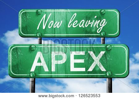 Now leaving apex road sign with blue sky