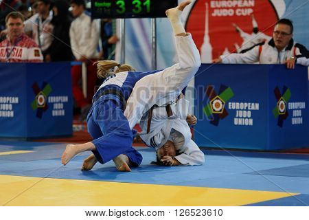 ST. PETERSBURG, RUSSIA - APRIL 16, 2016: Match Amber Gersjes of Netherlands (blue) vs Mariam Eserkeeva of Russia during the Junior European Judo Cup. 346 athletes participated in the competition