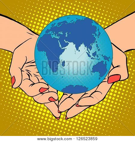 Planet Earth in hands pop art retro style. Earth day, environment Day. Ecology and nature. Female hands. Eurasia, Africa, Australia and Antarctica