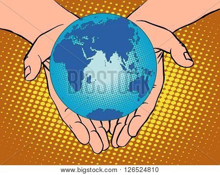 Planet Earth in hands pop art retro style. Earth day, environment Day. Ecology and nature. man hand. Eurasia, Africa, Australia, Antarctica, Europe, Asia