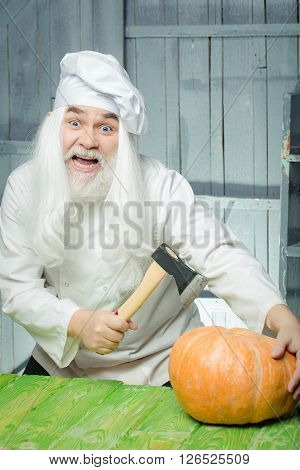 Cook With Axe And Pumpkin