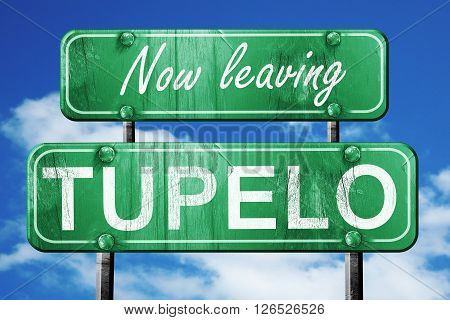 Now leaving tupelo road sign with blue sky