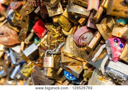 FRANCE PARIS - JUNE 01: Pont des arts - bridge across Seine river crammed with lovers padlocks on June 01 2015.