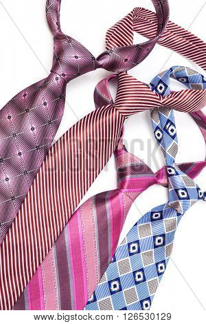 four necktie knotted on a white background