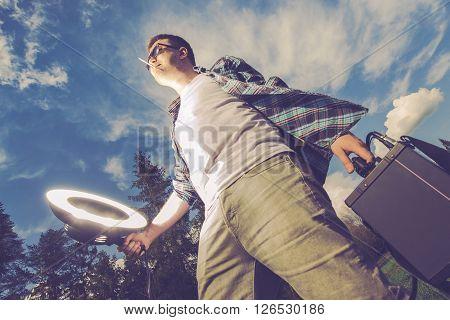 Mobile Flashlight Strobelight Photography Funny Concept. Young Men Enjoying Storbe Light White Caring and Using Flashlight on Himself. Mobile Flash Lighting Men