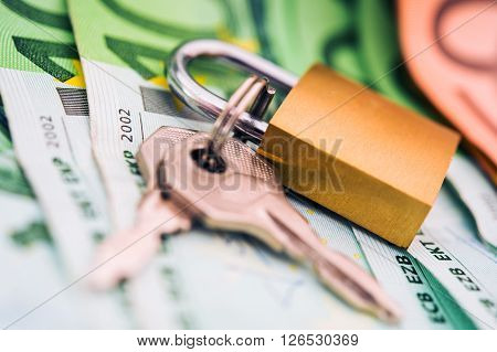 Safe Cash Money Deposit. Banking and Financial Concept with Metallic Padlock on the Euro Cash Money.