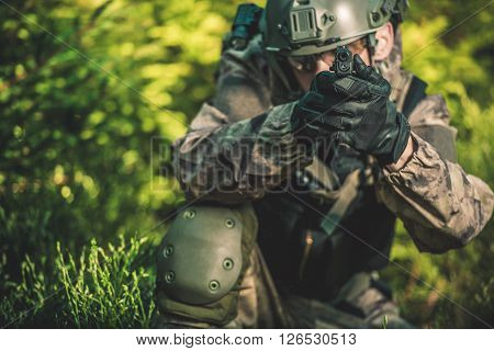 Solider with Handgun. Special Forces Military Mission Concept Photo.