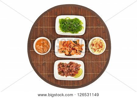 Three Seafood Salads On Bamboo Mat