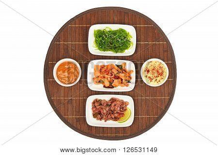 Three Seafood Salads On Bamboo Mat