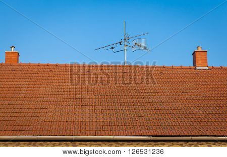 roof house with two smokestacks and antennae