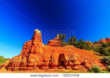 Unique vermilion-colored rock formation and stands of Ponderosa pines make the canyon exceptionally scenic.