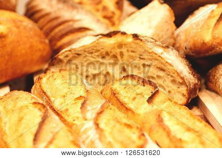 Different types of fresh baked bread. Selective focus.