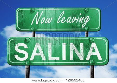 Now leaving salina road sign with blue sky