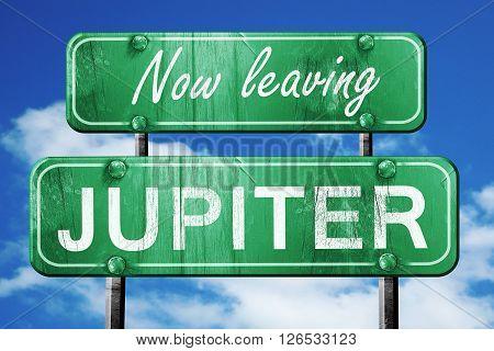 Now leaving jupiter road sign with blue sky