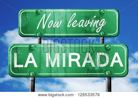 Now leaving la mirada road sign with blue sky