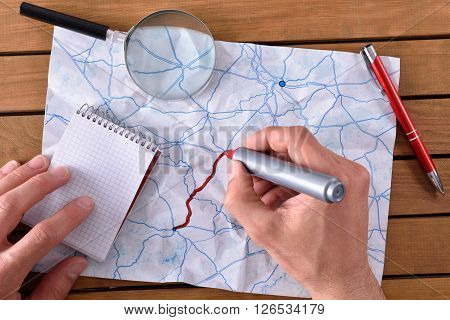 Hands Tracing A Path On A Map