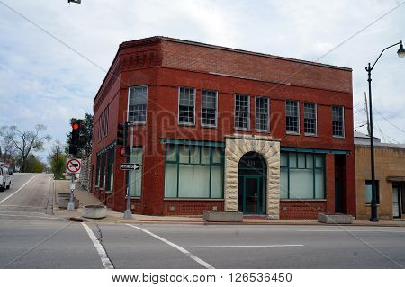JOLIET, ILLINOIS / UNITED STATES - APRIL 19, 2015: The red brick building which houses Warehouse Workers For Justice, near downtown Joliet.