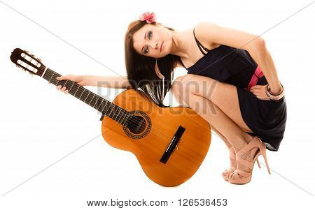 Travel vacation concept. Music lover summer girl hippie style in full length holding acoustic guitar isolated on white