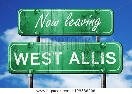 Now leaving west allis road sign with blue sky