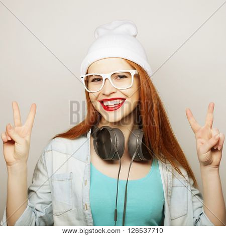 lifestyle and people concept: lovely woman showing victory or peace sign