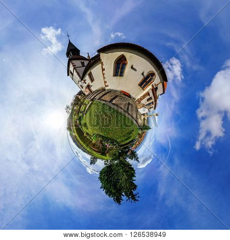Funny street view of little french village. Curvature of space, little planet effect, panoramic view.