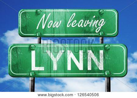 Now leaving lynn road sign with blue sky