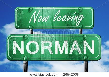 Now leaving norman road sign with blue sky