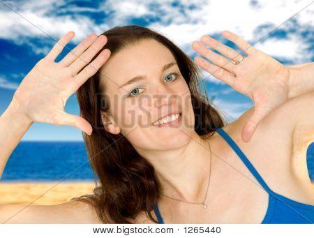 Girl At The Beach Doing The Handframe