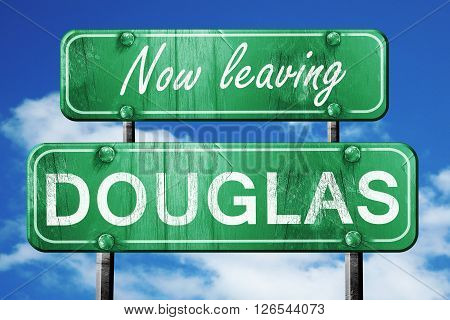 Now leaving douglas road sign with blue sky