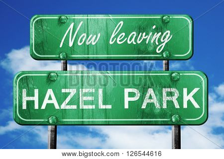 Now leaving hazel park road sign with blue sky