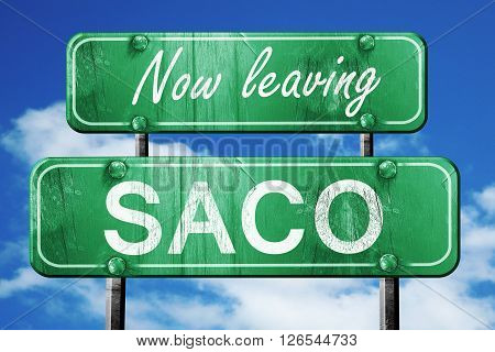 Now leaving saco road sign with blue sky