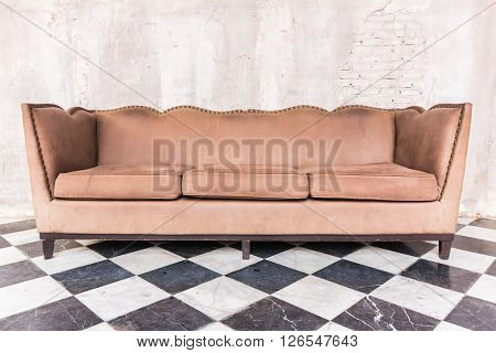 Antique Sofa Against Old Stucco Background