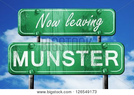 Now leaving munster road sign with blue sky