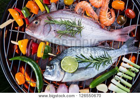 Barbecue grill with sea fishes, close-up.